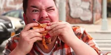 Broadway star, Benny Elledge eats a greasy burger in the Unjunk Yourself music video.