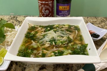 Steamed shredded Chicken breast served with Rice noodles in Chicken bone broth.  Gluten-free dish.