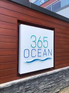 Illuminated wall sign with push through acrylic letters.
