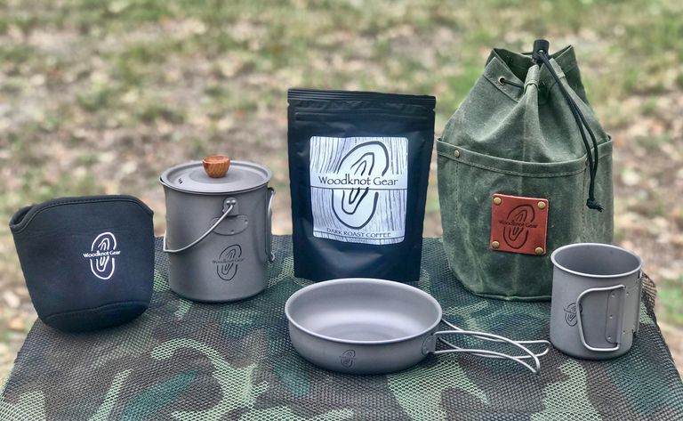 750ml coffee press with insulation coozie, coffee, wax canvas bag, fry pan and 300ml companion cup.