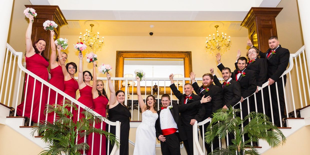 Wedding Party on both sides of the Stair Case having a blast with Hollywood