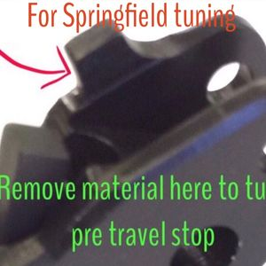 For Springfield triggers, remove material under this tab for pre travel increase