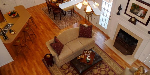 View from balcony bridge looking at beautiful hardwood floors and fireplace