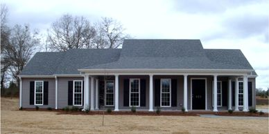 Country classic one level home design with wrap-around front porch. The Abbeville VI-RB with bath option B