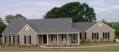 Country classic one level home design with wrap-around front porch.  the Barnwell  V-L with Double Garage