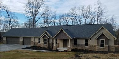 Affordable, One Level Craftsman Home Design with real rock detail The Batesville-Alpine V with Side Triple Garage