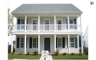 Classic home design with 2 story front porch off of master bedroom The Conway