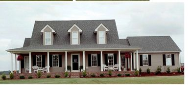 Country farmhouse home design with wrap-around front porch Freemont III with Double Garage