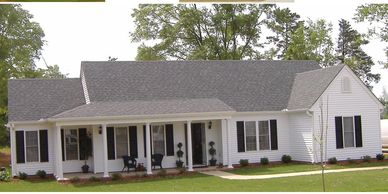 Country classic one level home design with wrap-around front porch. The Leesville V with Rear Garage