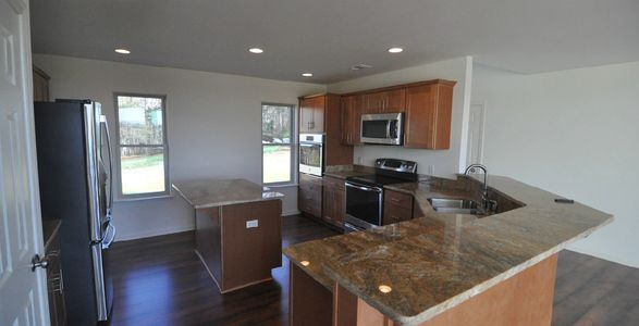 Chefs kitchen with granite countertops, breakfast bar, and high-end appliances