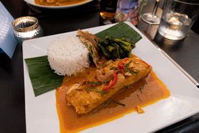 Salmon panang curry with Thai spring onion omelette and spring green.