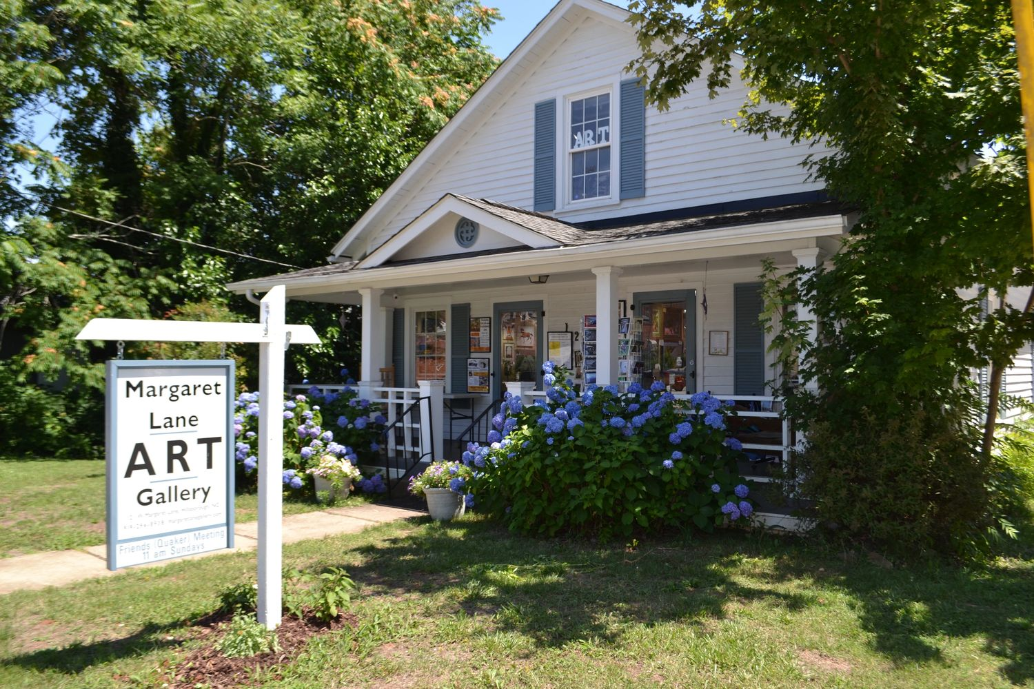 Margaret Lane Gallery, street view, in the spring when the hydrangeas are blooming.