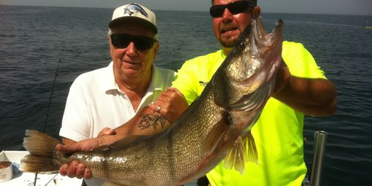 Captain Tim and Chuck with longest walleye