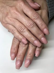 Nude Natural Nails done using Structure Manicure Service