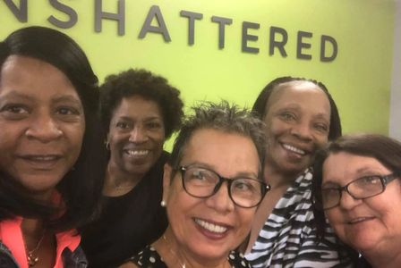 CoachGlo with women at Unshattered