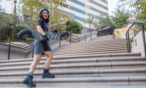 Mary Christina Brown carrying a SpeedBoard in DTLA. #esk8