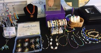 Table display of key chains, anklets, and pendants.