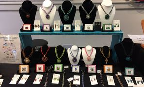 Creative Obsession birthstone color jewelry on displays.
