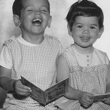 The young Deprise entertains her brother Jim even back then!
