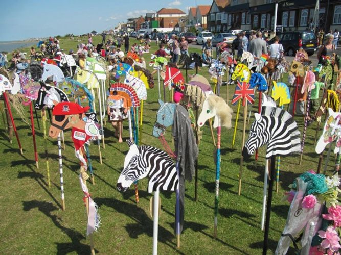 Hobby Horse or Stick horses gathering for an Event at the seaside.