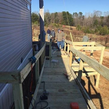 Five from St. Andrews, Habitat for Humanity, and several of the homeowner's neighbors and friends.