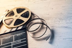 Reel of film and clapper