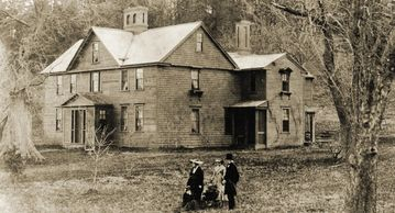 Orchard House c. 1865 with members of the Alcott family in the foreground