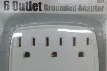White 6-outlet  3-prong wall mounted power adapter turns any two plug outlet into a 6 plug outlet .