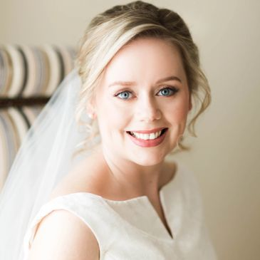 Bride smiling with natural bridal makeup
