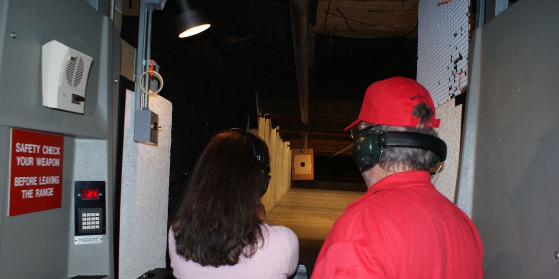 Coaching a student as she shoots her IL Concealed Carry License qualification at the range.