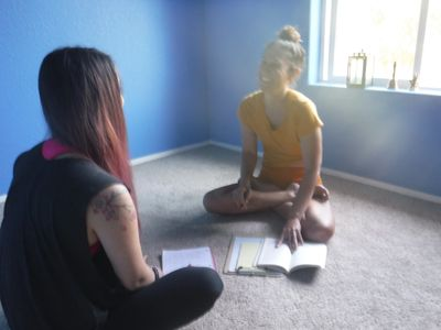 Carly Chang and Marissa Lee Harris discussing Yoga Nidra techniques on a sunny Saturday morning