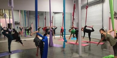 "Brittany Steckel ""Bri"" teaching an aerial yoga class at Polecats Aerial Fitness in Las Vegas, 2016-ish"