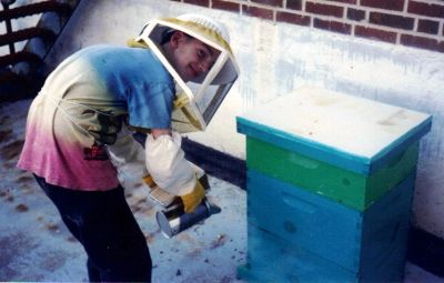 Young Anthony smoking a hive that he placed at a local school.