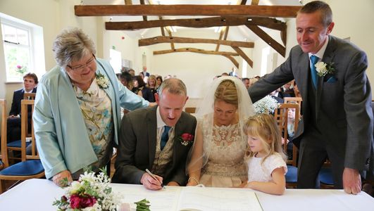 Mother of the bride navy trousers, floral top and aqua swing jacket made by Susie Grist Couture