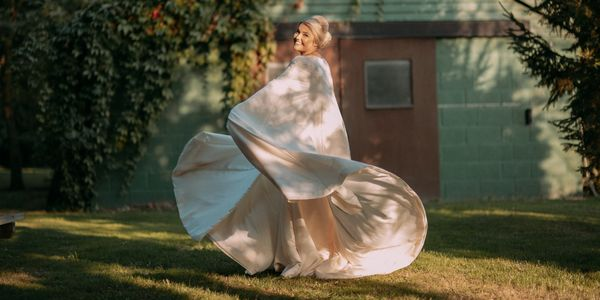 Ivory satin wedding cape and dress made by Susie Grist Couture