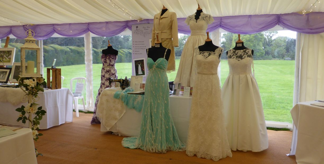 Selection of dresses made by Susie Grist Couture on display at a wedding fair