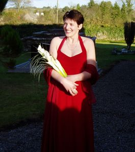 Red silk satin halter-neck wedding dress made by Susie Grist Couture