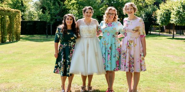 Mary wearing her 1950's style lace and tulle wedding dress that I altered for a perfect fit along with her bridesmaids in their gorgeous floral dresses that I also altered.