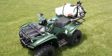 ATV sprayer with short tank saddles and dual boomless nozzles.