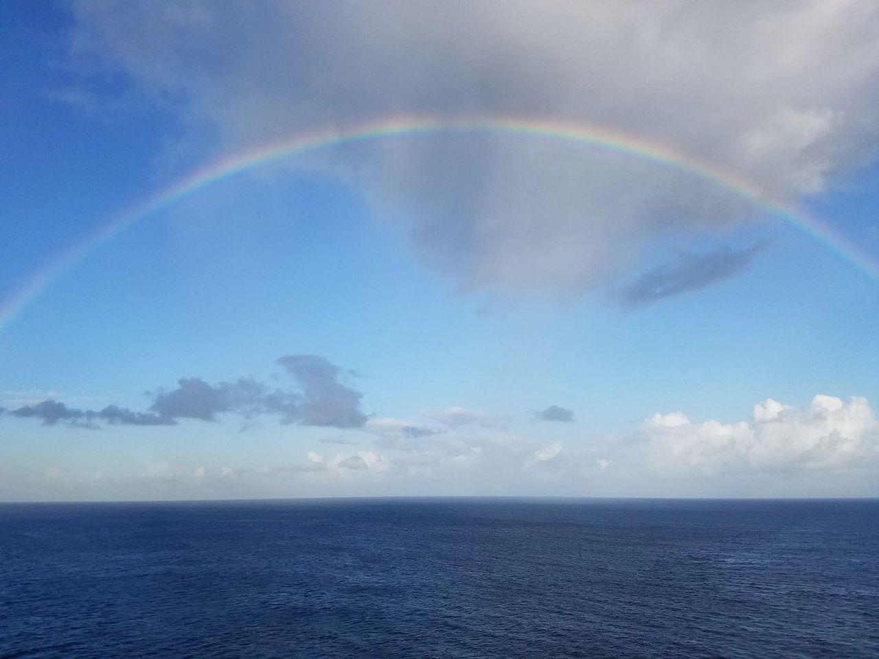 Full rainbow over open ocean
