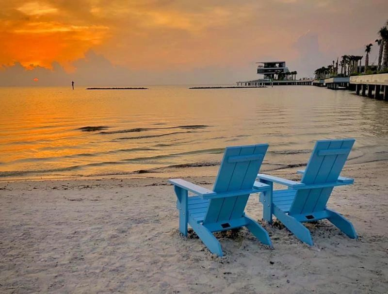 Sunset at the pier with beachchairs