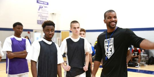 Players from the Southwest Florida Area work  with coach Aaron Holmes during a fall exposure event