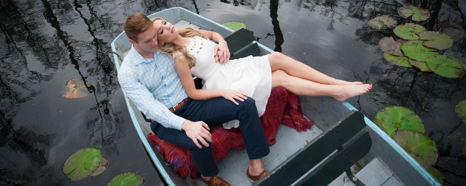 Welcome to Jason Cole Photography - Young couple in love in a small boat among trees, lily pads.