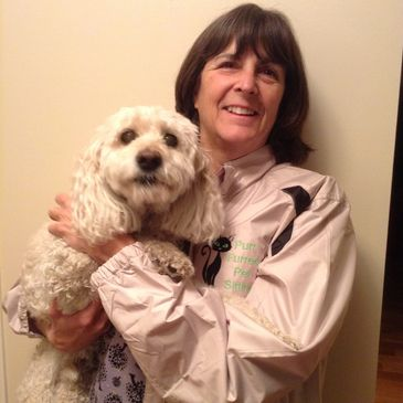 Laura Marshall with her dog Mick, care giver with Purr Furred Pet Sitting Inc in Calgary Alberta.