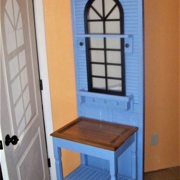Blue louvered doors w/repurposed oak cabinet door, handcrafted table base & shelves