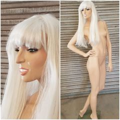 "A restoration resembling Lady GaGa.  5'11"" tall. 32 25 33 rod and base included, wig not included"