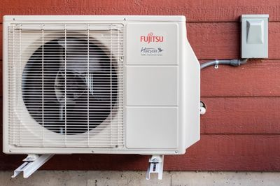 Fujitsu Mini split hung on outside of a home