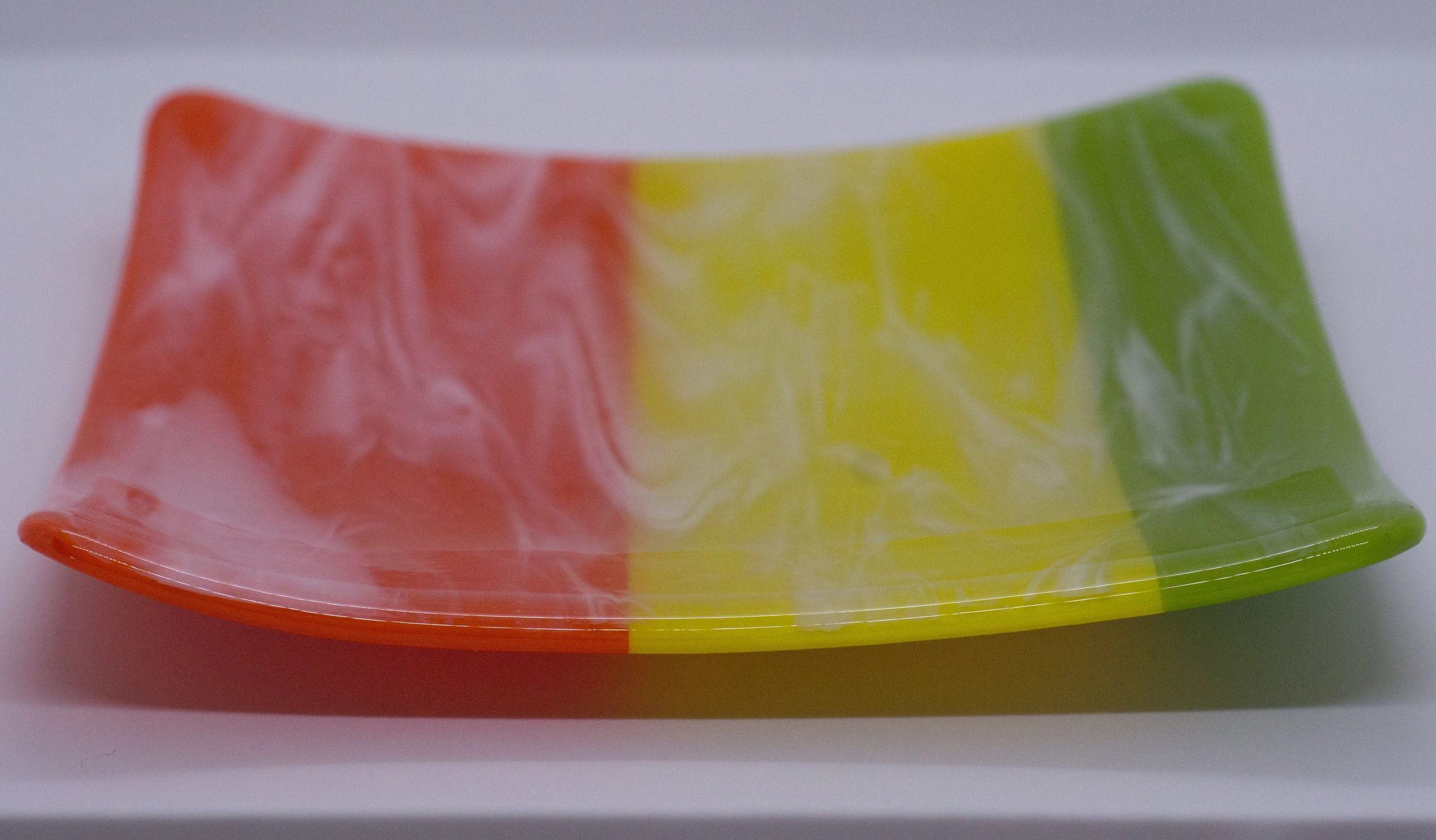 Orange, yellow and green fused glass plate