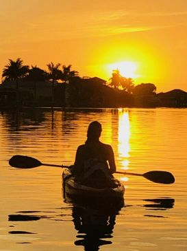 kayaking during sunset