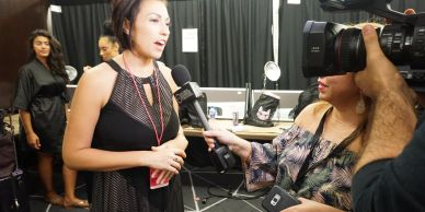 Amanda May being interviewed at Miami Swim Week for Sports Illustrated Runway Show